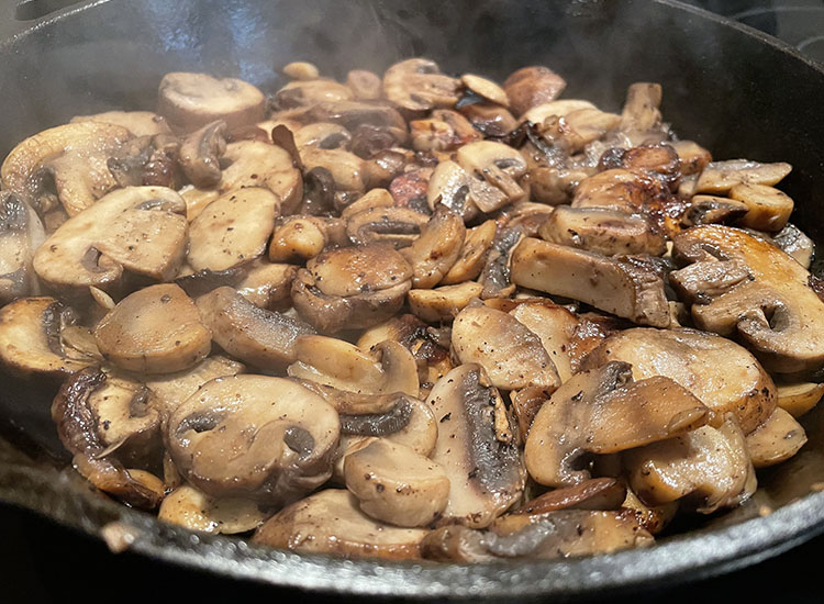 cooked bella mushrooms in a pan