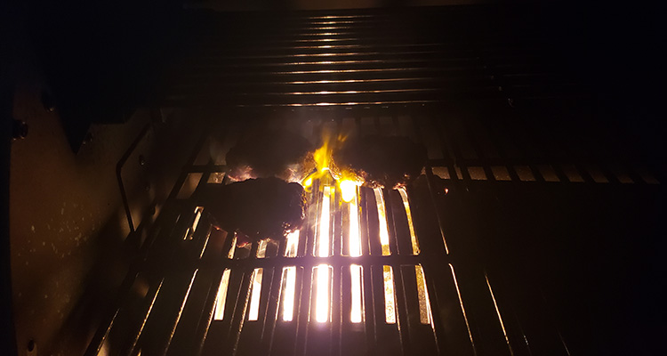 steaks on a grill