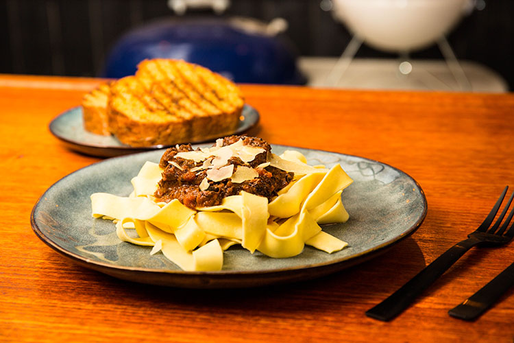 leftover brisket bolognese with pasta and garlic bread