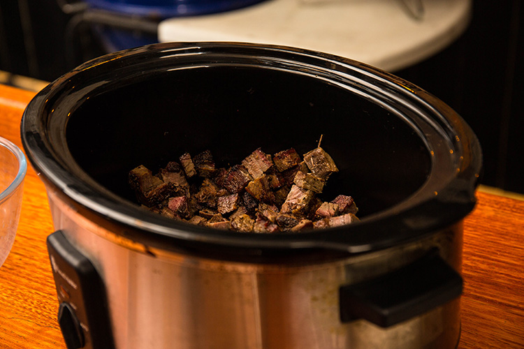 diced brisket in a slow cooker