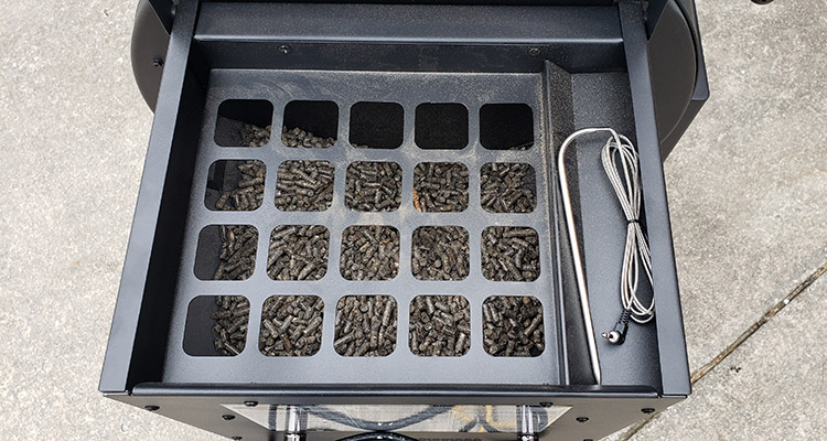 pellet hopper with a meat probe storage space