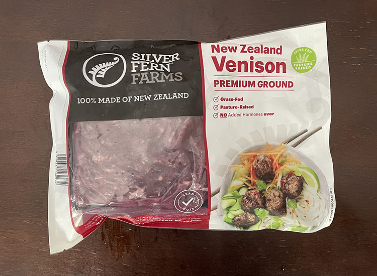 packaged ground venison from silver fern farms on a wooden table