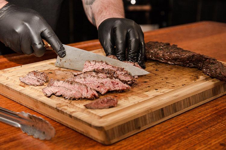 slicing grilled skirt steak