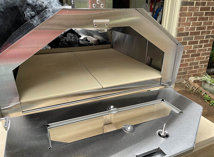Ooni Pro 16 pizza oven with open front door and inserted pizza stones