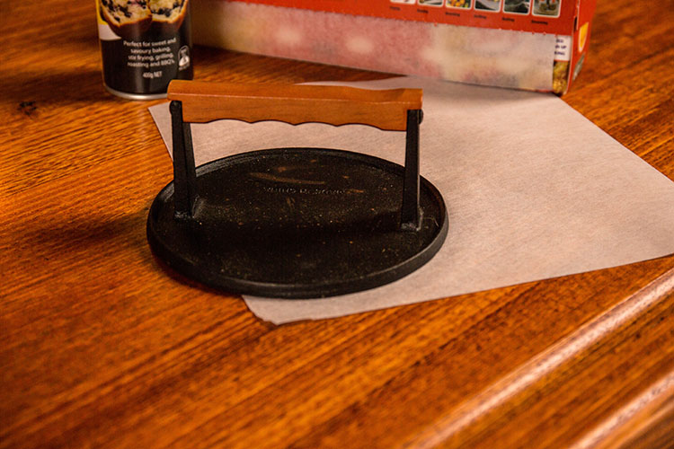 burger smasher on a wooden table