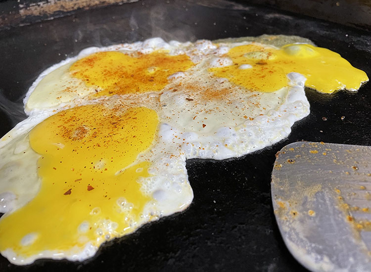 eggs cooking on a griddle