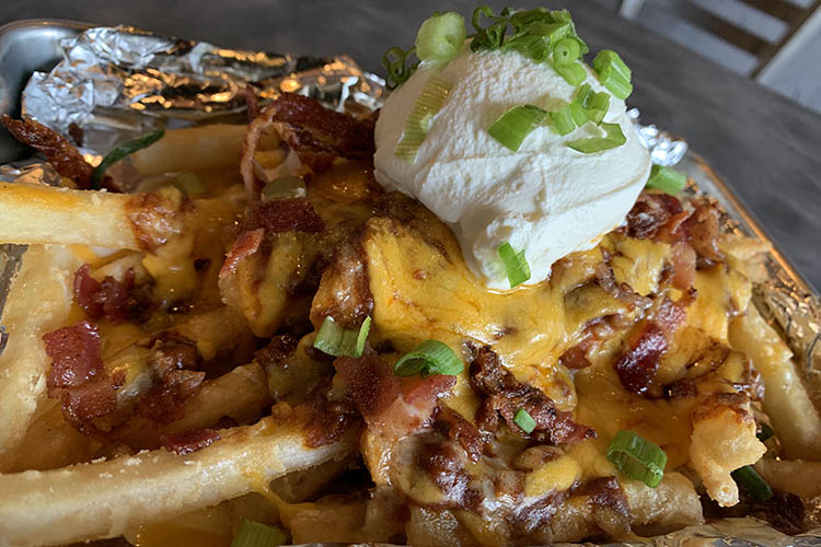 french fries with meat, cheese and sour cream