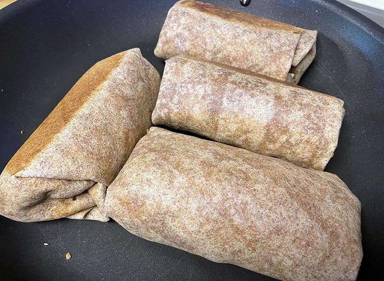 brisket breakfast burrito on a frying pan