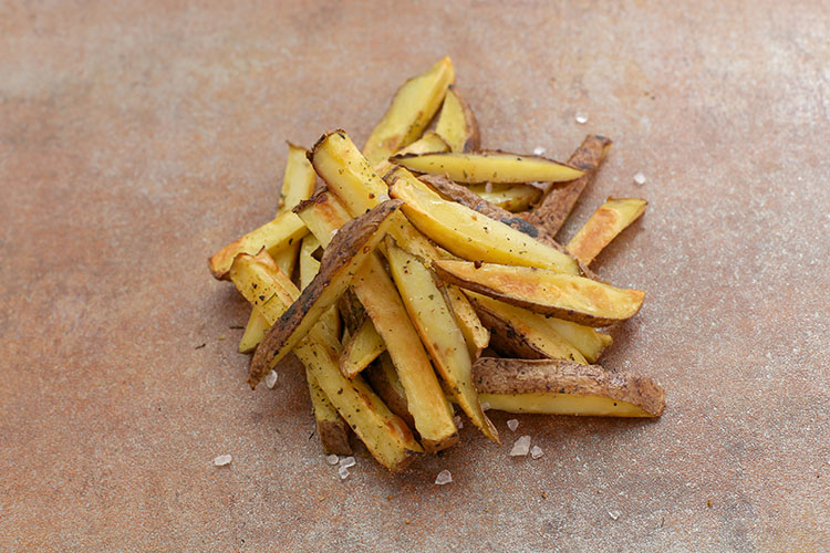 seasoned french fries on a parchment paper