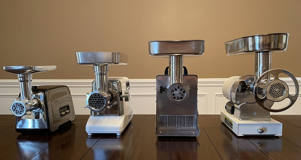 selection of meat grinders on a table