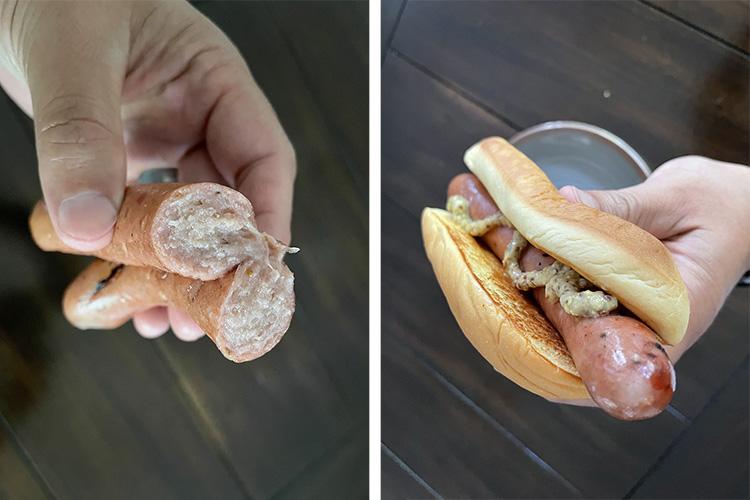 a man holding smoked homemade hotdog in a bun