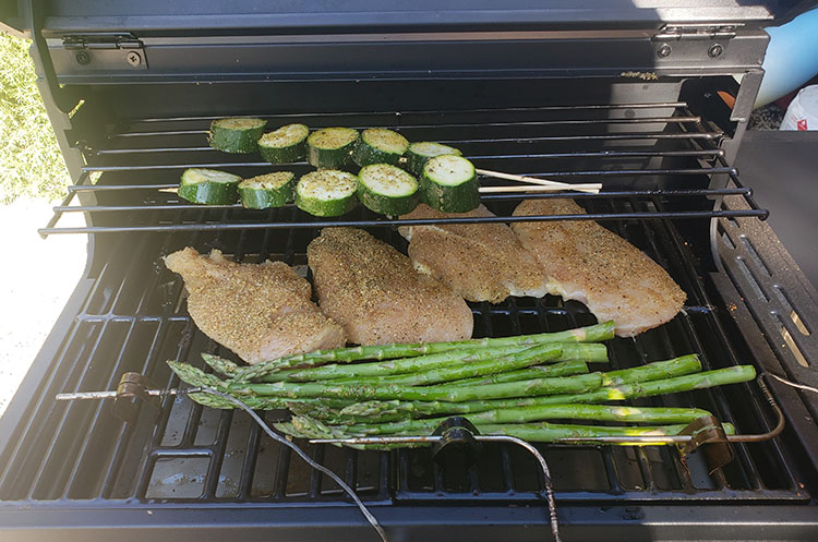 chicken breasts and vegetables cooking on Bit Boss Sportsman Pellet Grill