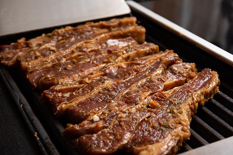 marinated korean bbq ribs on a grill