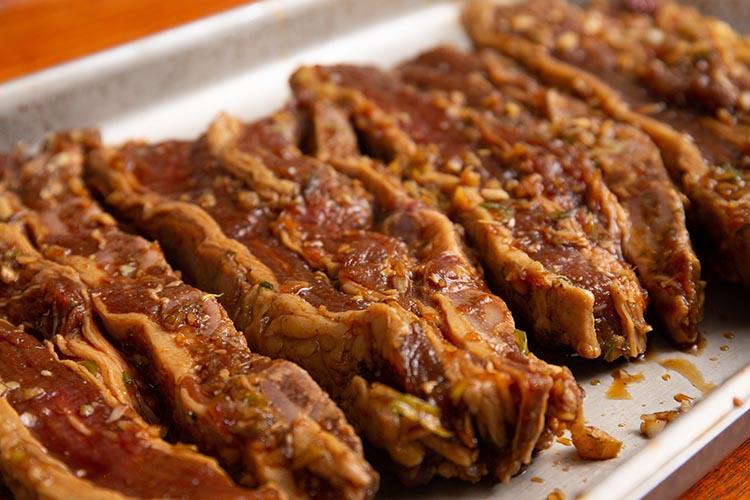 marinated korean beef short ribs on a metal tray
