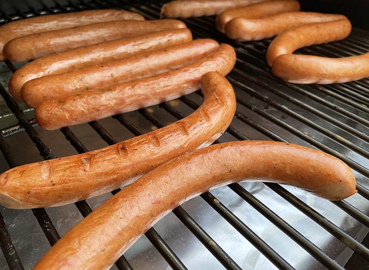 smoked homemade hotdogs on a smoker