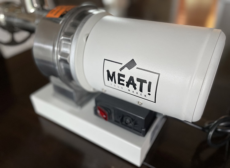 meat! your maker grinder with a logo close up