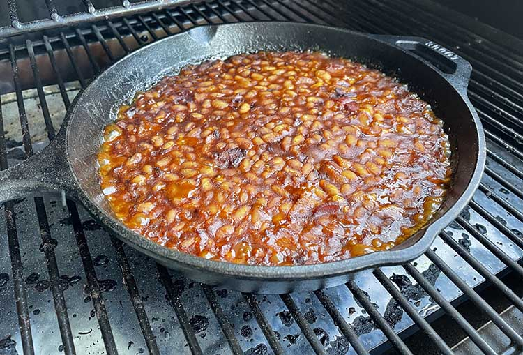 Smoked beans in smoker at the end of cooking