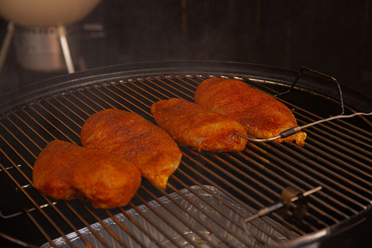 Chicken breasts in the smoker with a temperature probe