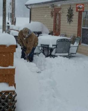 Submitted by Robin Jackson - Cross Plains, Tn. My husband shoveling a path to our back door. We have well over 12 inches of snow.