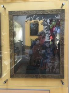 Mirror selfie through Chinese painted scene