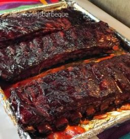 ribs just out of the smoker with smokin js barbeque logo