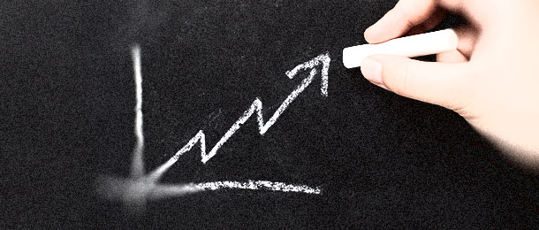 An upward-pointing arrow graph on a chalkboard.