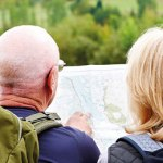 A man and a woman read a map.