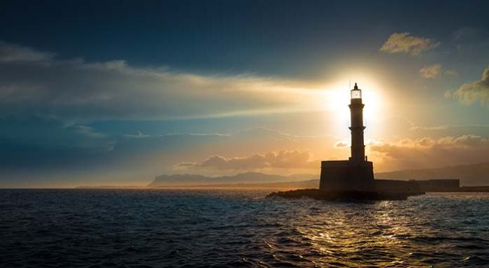 Lighthouse at night with beam of light