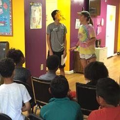 Meg & R.J. leading skit during Kids Club. 5 Stars for these 2.