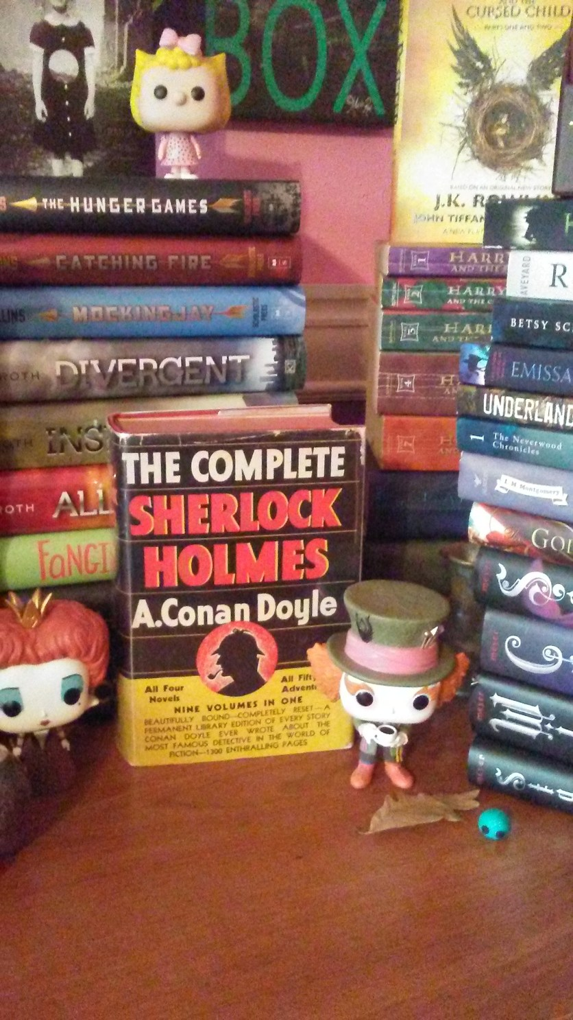 Here is the Mad Hatter and Queen of Hearts standing in front of a behemoth Sherlock Holmes collection that could literally murder my face...