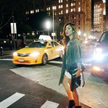 Claire being modelly trying to catch a cab in NY.