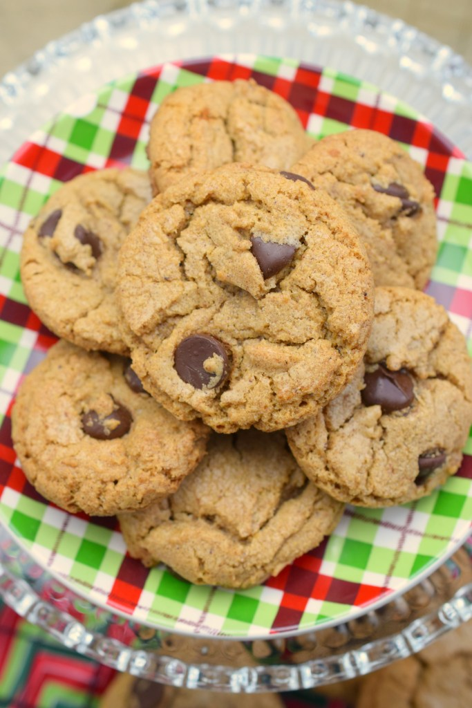 stack of cookies on festive holiday plate on top of glass plate