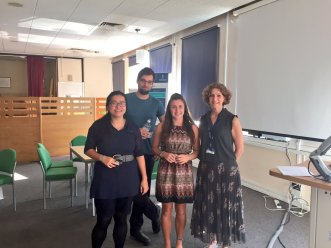 Winner of the award for the best presentation: Aimee Pink (second from right)