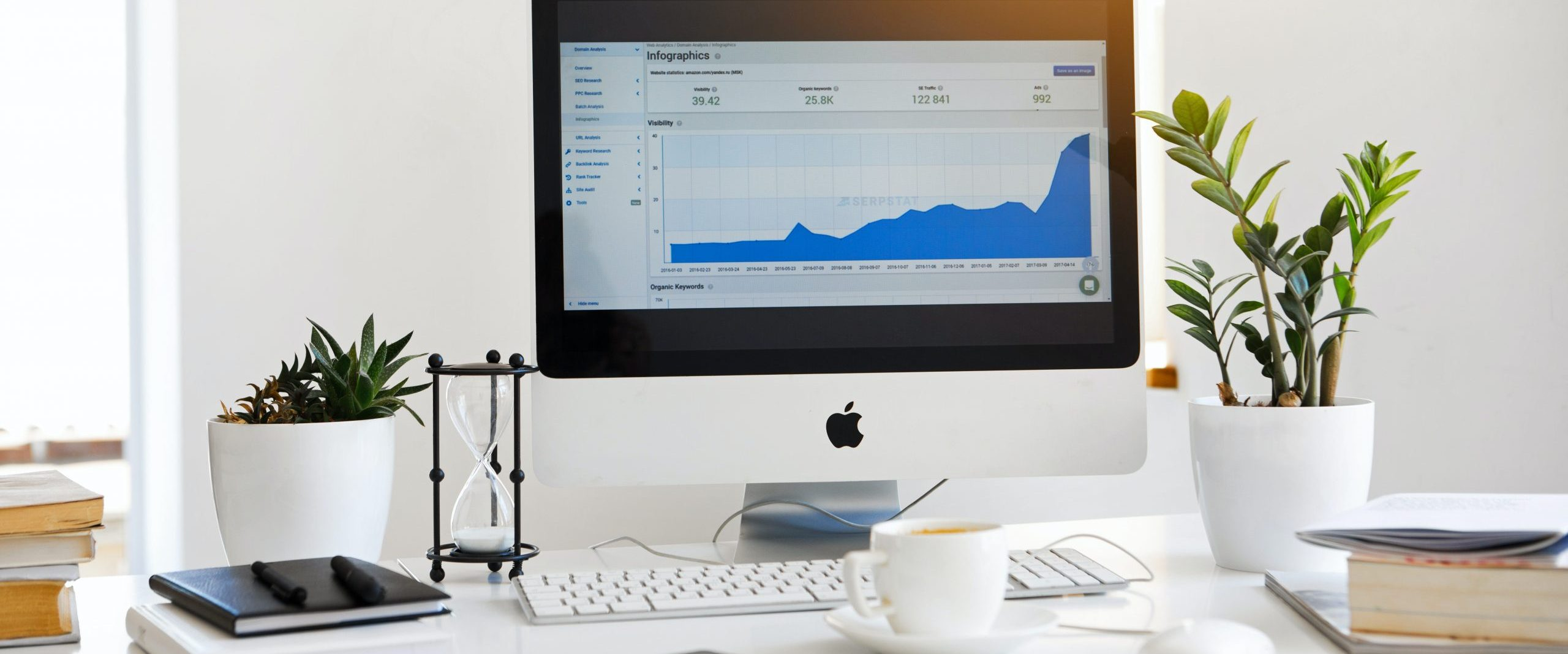 wave accounting, accounting photo, desk with computer showing graph