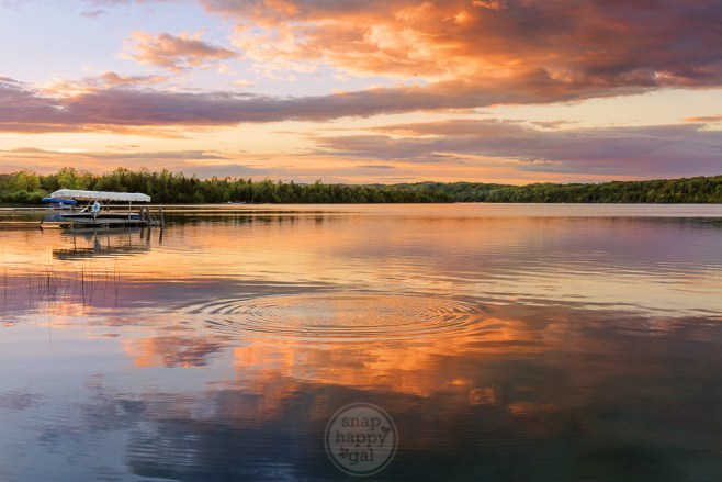 Sunset reflections and ripples in the waters of Cedar Lake outside Traverse City