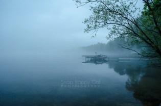 Photo: boat dock on Torch Lake, foggy morning