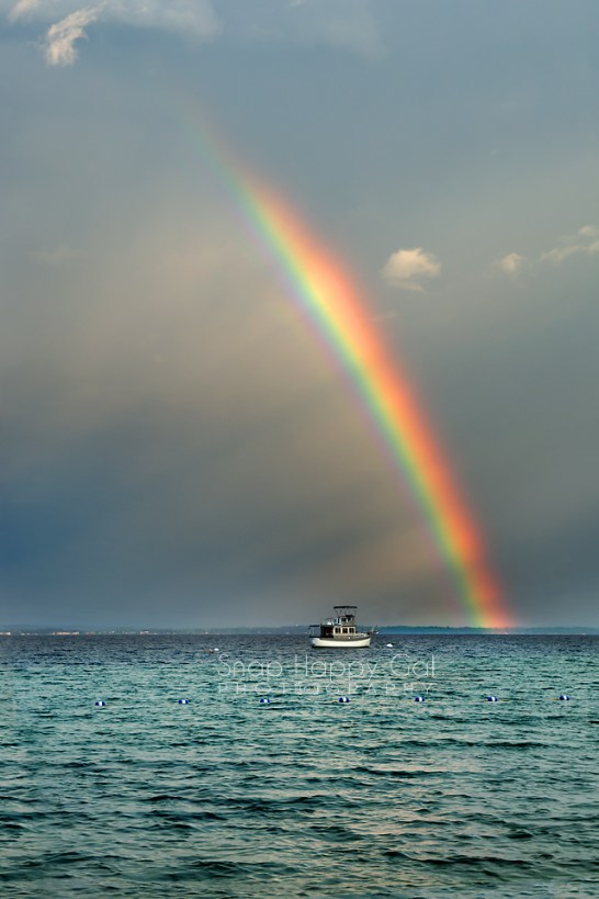 Photo: rainbow over a boat on Lake Michigan
