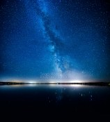 Photo: Panorama - A large swath of the Milky Way reflects in Torch Lake