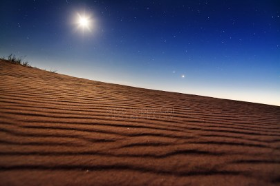 Photo: Moon and stars above undisturbed sand in the Sleeping Bear Dunes National Park