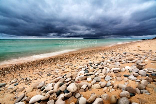 Photo: Dark clouds, Lake Michigan beach with stones