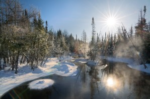 Photo: winter morning steam rises off the Rapid River