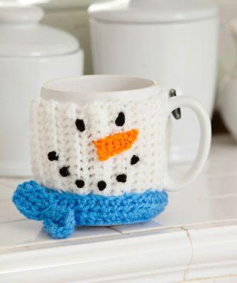 Snowman Mug Hug from Red Heart Yarns.