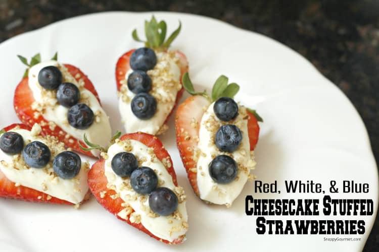 Cheesecake stuffed strawberries on white plate