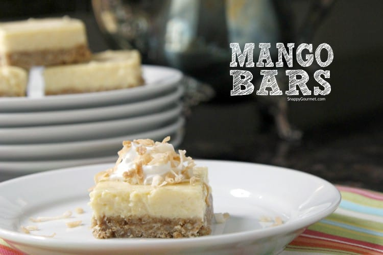 Mango Bars on plate with whipped cream and toasted coconut
