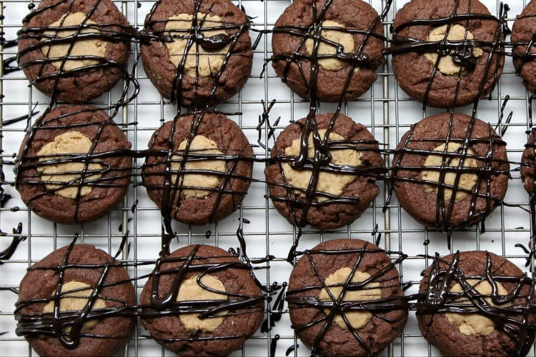 Buckeye Thumbprint Cookies - chocolate and peanut butter cookies with drizzled chocolate. SnappyGourmet.com