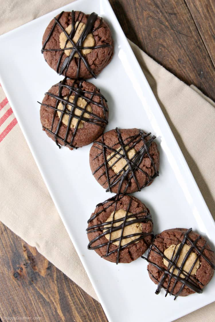 Buckeye Thumbprint Cookies - easy chocolate and peanut butter cookies with drizzled chocolate. SnappyGourmet.com