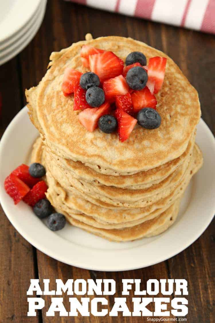 stacked almond flour pancakes with strawberries and blueberries