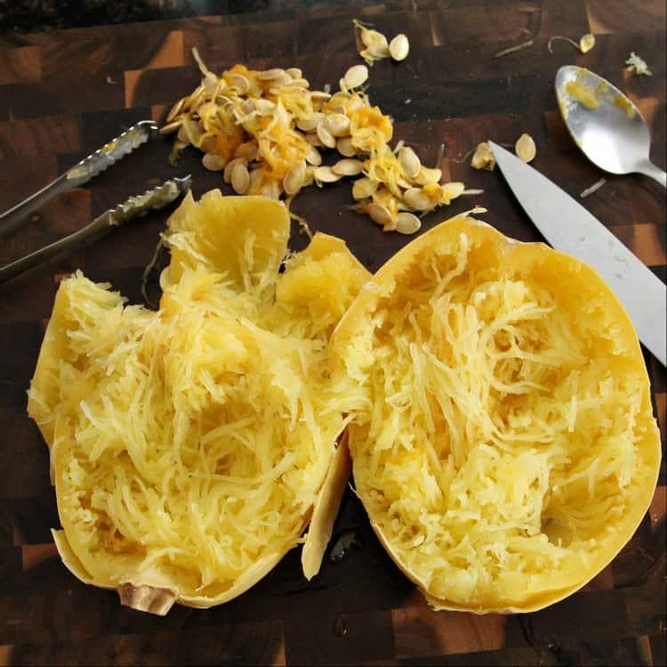 Pesto Alfredo Spaghetti Squash Casserole Recipe - shredding the spaghetti squash into strands