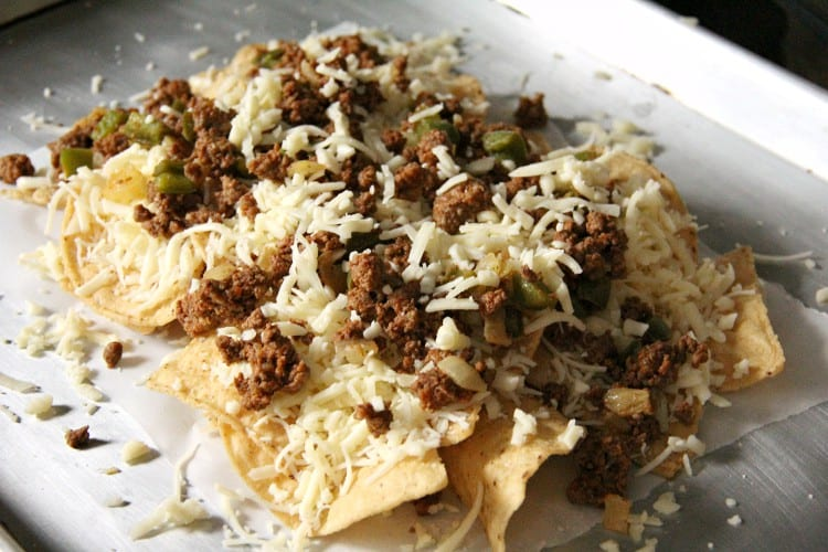 loaded nachos on pan before baking in oven