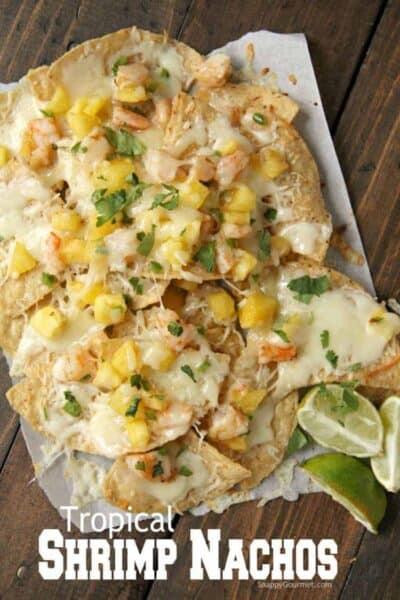 shrimp nachos with lime wedges